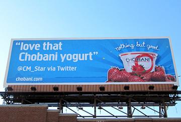 Using billboard advertising to Tweet about Greek yogurt.