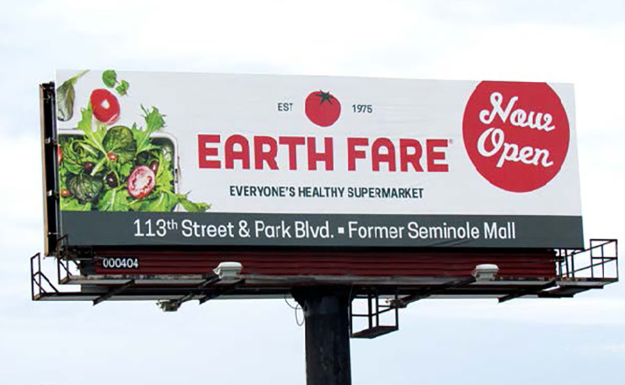 A billboard advertisement for a grocery store