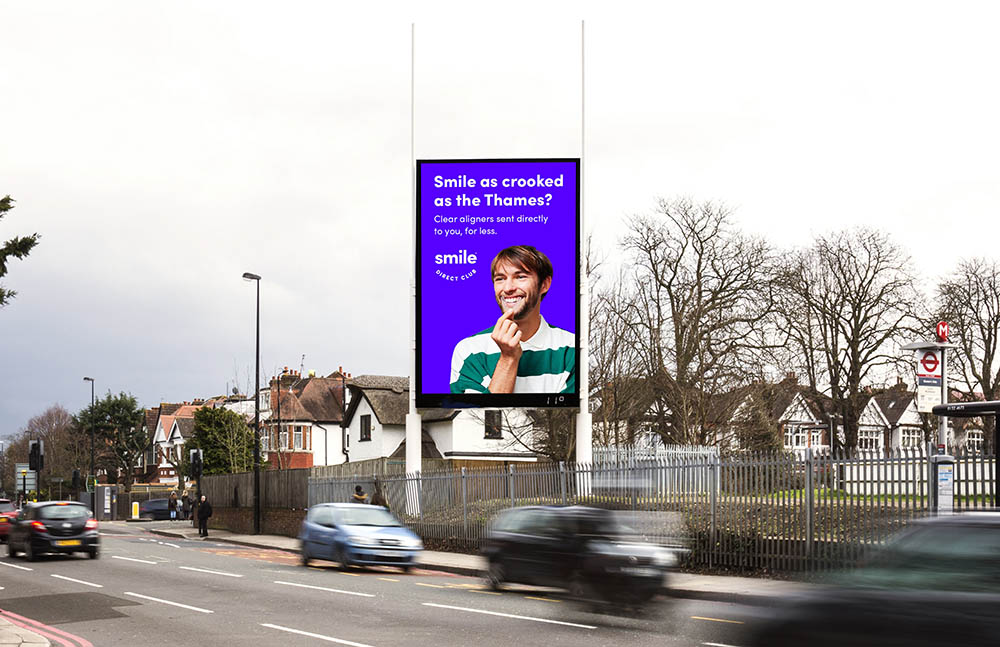 A digital billboard with traffic passing by.
