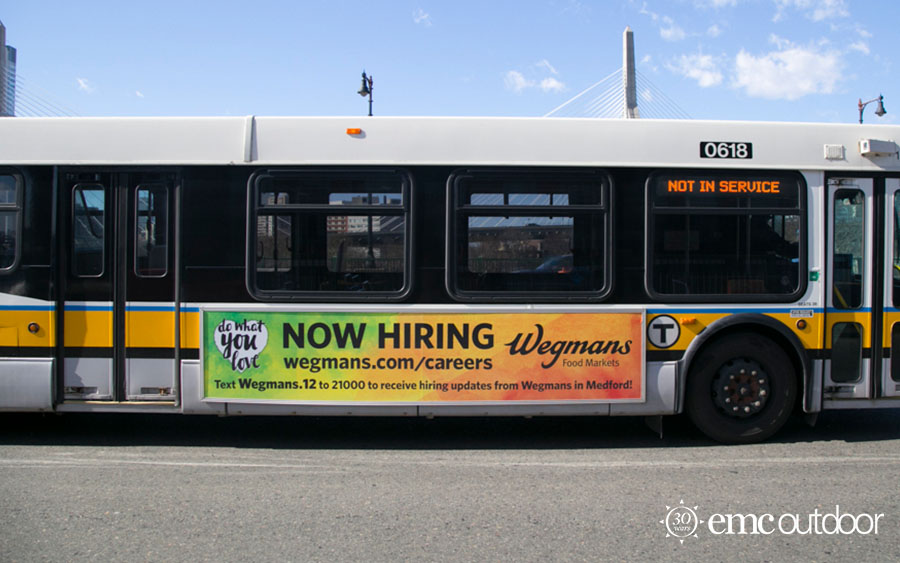 A bus with a now hiring ad