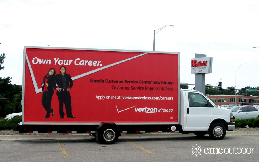 A mobile billboard with a now hiring message