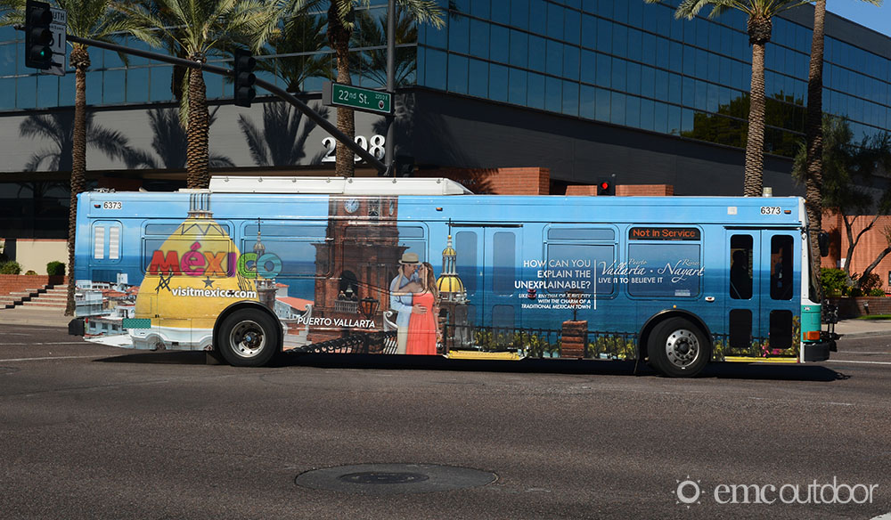 A wrapped bus with advertising for Mexico Tourism