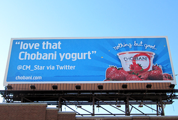 Using billboard advertising to Tweet about Greek yogurt.