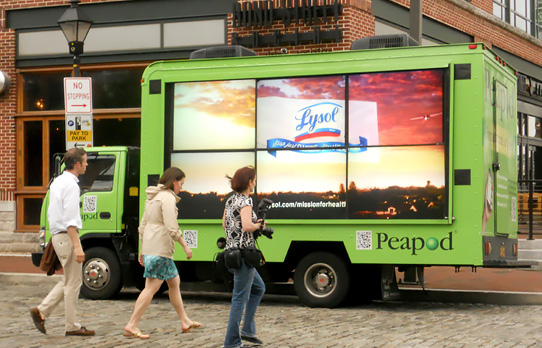 Image of video mobile billboard advertsing display used to reach an urban audience