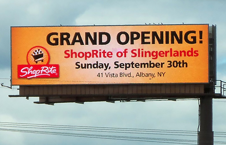 Image of a digital billboard used by a regional supermarket chain to promote a grand opening