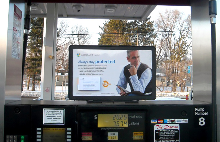 Image of a national gas station advertising campaign for an insurance provider