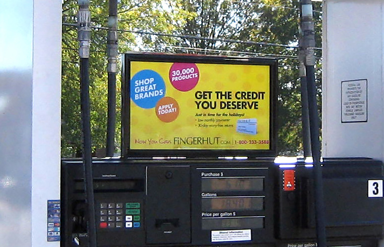 Image of gas station advertising media used to promote a website