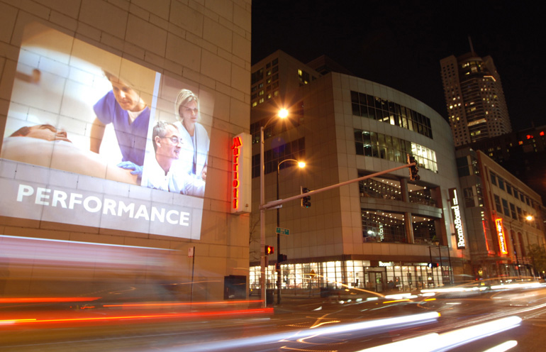 Mobile projection advertising for an event in Chicago