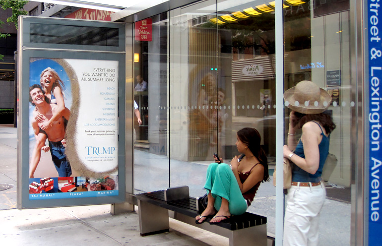 Image of a transit shelter ad in New York for a resort destination