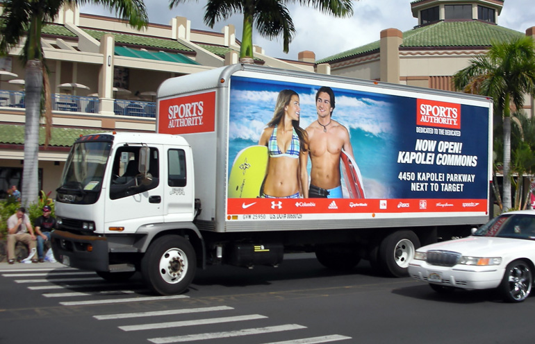 Image of truckside advertising in Hawaii to promote the grand opening of a retail location