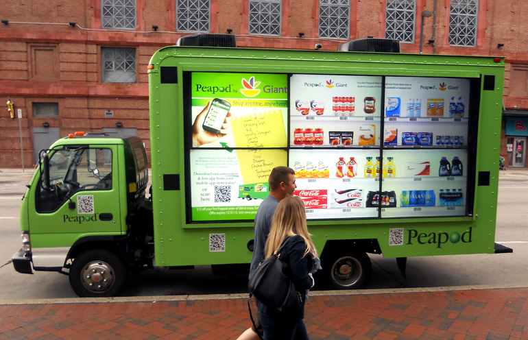 Image of video mobile billboard advertising to promote a grocery delivery service